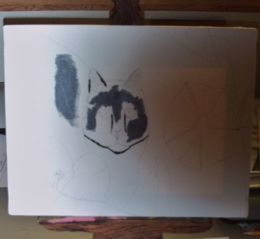 Here I am using gray and white paint to fill in the details of Maxx's face.