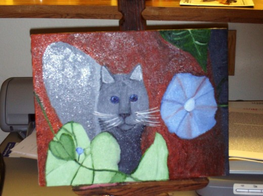 I saved money by painting a picture of a cat next to a morning glory.  I used oil paints to create this illustration.
