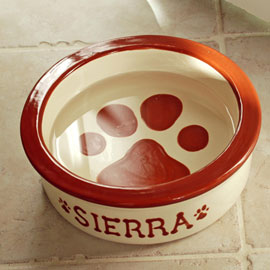 Personalized Dog Bowl Give your best friend a customized dish! Dont bother him...hes eating out of his own, personalized dog bowl! Let us customize this handsome dish with your pets name at no extra charge  theres room on the outside for up to 12 let
