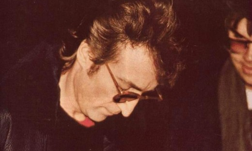 Lennon signs an autograph for Mark David Chapman