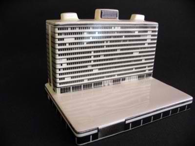 Miniature building on laptop computer