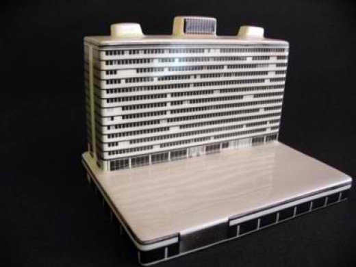 Miniature building on laptop computer