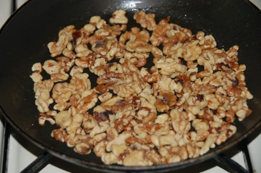 The walnuts can be toasted in the oven or on the stove top, about  1-2 minutes in a Tbs. butter should do the trick!