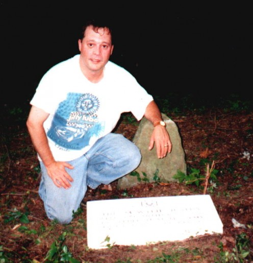 Robert M. Baker at the grave of his ancestor, Hiram Wylie Justus, on Laurel Creek, Buchanan County, Virginia.