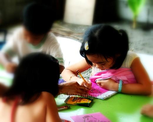 teacher and pupil writing