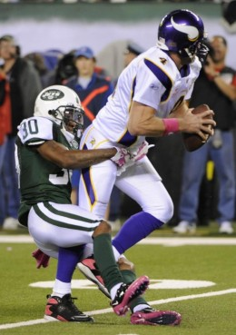 Minnesota Vikings quarterback Brett Favre is sacked by New York Jets' Drew Coleman during the first quarter of an NFL football game Monday, Oct. 11, 2010, in East Rutherford, N.J. (AP Photo/Bill Kostroun)