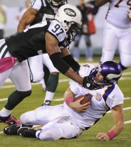 Minnesota Vikings' Brett Favre is sacked by New York Jets' Calvin Pace during the second quarter of an NFL football game Monday, Oct. 11, 2010, in East Rutherford, N.J. A facemask penalty was called on Pace on the play. (AP Photo/Bill Kostrou