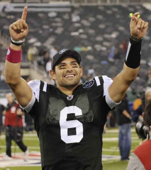 New York Jets quarterback Mark Sanchez (6) gestures to fans after the fourth quarter of an NFL football game between the Minnesota Vikings and the New York Jets Monday, Oct. 11, 2010, in East Rutherford, N.J. The Jets won the game 29-20.