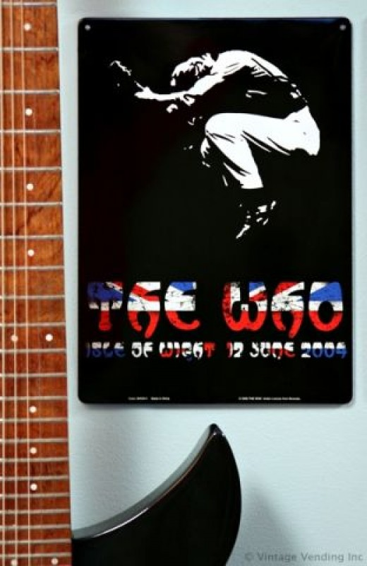 Cool way to display your guitar with a tin sign
