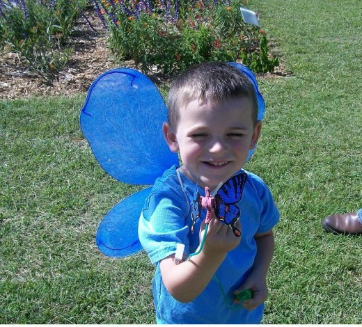This young man enjoyed showing how his butterfly toy worked.  And he informed everyone that he liked being a BLUE butterfly.