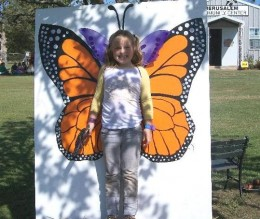 Big sister smiles beautifully as a Monarch!