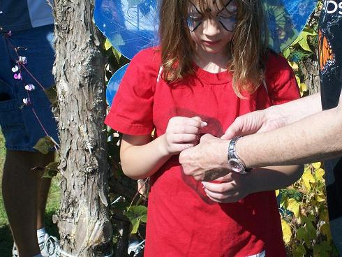 This lucky girl carefully prepared to tag a Monarch before she helps release it.
