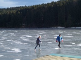 Ice skating on the Pack lake in winter