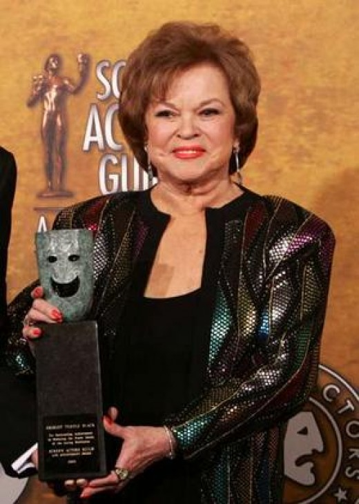 A mature Shirley Temple accepts an award from the Sceen Actors Guild