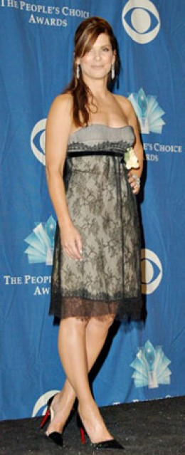 Sandra Bullock in lace baby-doll dress with Louboutin shoes at the People's Choice Awards in Los Angeles.