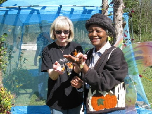 Linda Schemmer and Loretta Jackson are going to release  Monarchs  to start  their instinctive flight. Loretta came all the way from Chickasha to visit the Festival.  Photo permission by Kay Webb.