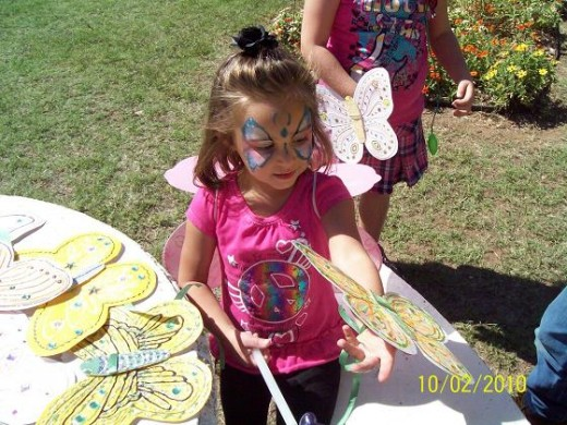 Picking out a butterfly to wear in the Childrens Butterfly Parade.