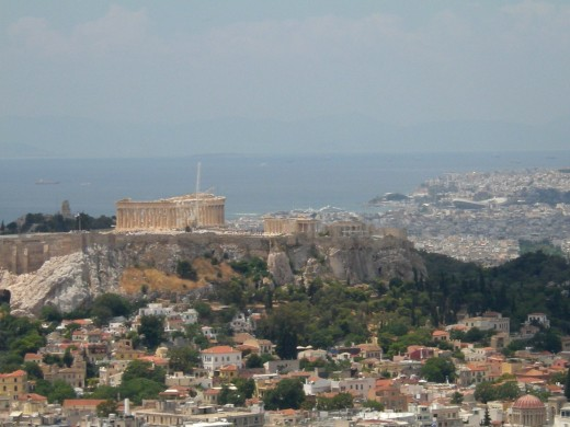 Acropolis on the left; Piraeus and the Phalerus on the right, in the distance