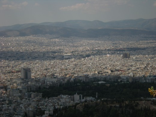 The chain of mountains and the city in the vast plain