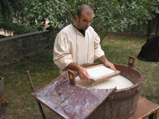 A man making paper, using ancient methods.