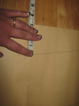 After tracing your pattern use your tape measure to measure one inch all the way around your pattern (except for the top where it will be two inches) marking it using your pencil.