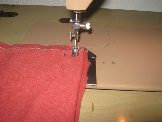 When you have pinned your pieces together you will sew just the J parts on each side. You seam should be about 1/4-1/2 an inch from the edges.