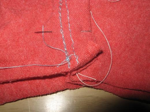Pin at the crotch.