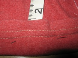 Use your tape measure and fold the material at the waist over. You want the pocket that doing this is making to measure 11/2 inches. Pin material in place. Do this until you have a waist band all the way around.