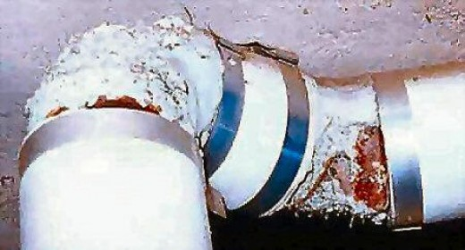 asbestos on damaged steam pipe joint