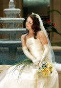 Beautiful example of pastel flowers with an ivory wedding gown.