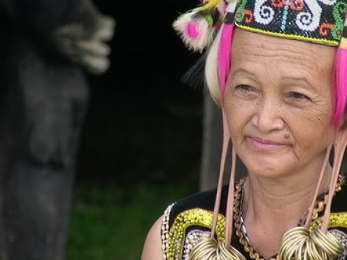 The long ear is symbol of beauty for Dayaknese woman. Imagine if I born in her time, as Dayaknese woman I will have that ear. @_@