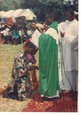 Fr. Kenneth Evurulobi:Blessing his Mama and Papa during his First Mass on 13th July, 1997 at St. Augustine's Catholic Station, Ntigha-Uzor.