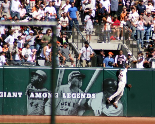 Barry making a great catch out in Left Field...his position...with his sign behind him.