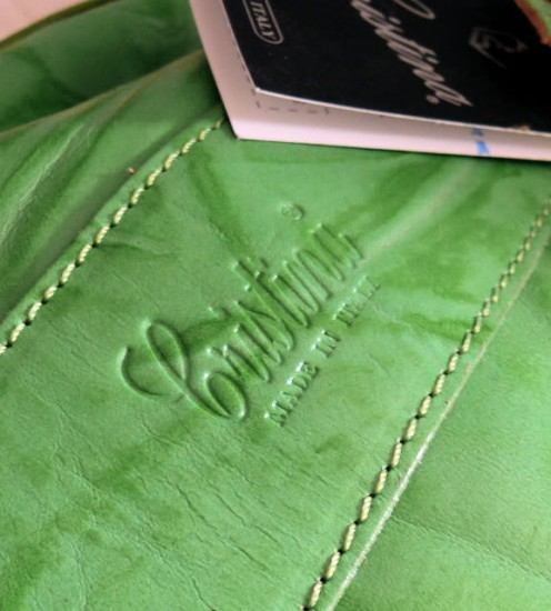"An up close shot of the embossed leather logo of a Cristina bag. Underneath reads ""Made in Italy."""