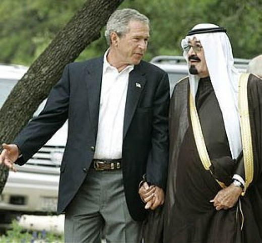 George Bush and King of Saudi Arabia holding hands. This is an unusual bromance by American standards.