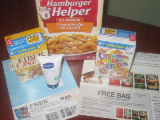 Coupon for single ZonePerfect Cookie Dough Bar, Coupon for 5 lb bag of dog food from Natura, Sample size Vaseline lotion, Samples of Cinnamon Toast Crunch and Fiber One, Full Size box of Hamburger Helper