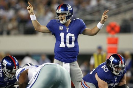New York Giants quarterback Eli Manning (10) calls out a play prior to the snap against the Dallas Cowboys at Cowboys Stadium in Arlington, Texas on October 24, 2010. (Aaron M. Sprecher/NFL)