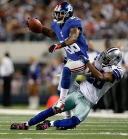 New York Giants wide receiver Hakeem Nicks (88) moves the ball against the defense of Dallas Cowboys cornerback Alan Ball (20) at Cowboys Stadium in Arlington, Texas on October 24, 2010. (Aaron M. Sprecher/NFL)