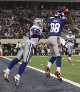 New York Giants wide receiver Hakeem Nicks, right, makes a touchdown reception as Dallas Cowboys safety Gerald Sensabaugh (43) defends during the first half of an NFL football game Monday, Oct. 25, 2010, in Arlington, Texas. (AP Photo/LM Otero)