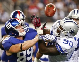 New York Giants tight end Kevin Boss and Dallas Cowboys defensive tackle Jay Ratliff grapple over a loose ball during the second half an NFL football game Monday, Oct. 25, 2010, in Arlington, Texas. The Giants won 41-35. (AP Photo/Mike Fuentes)