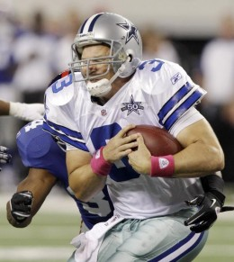 New York Giants safety Deon Grant sacks Dallas Cowboys quarterback Jon Kitna during the first half of an NFL football game Monday, Oct. 25, 2010, in Arlington, Texas. (AP Photo/LM Otero)