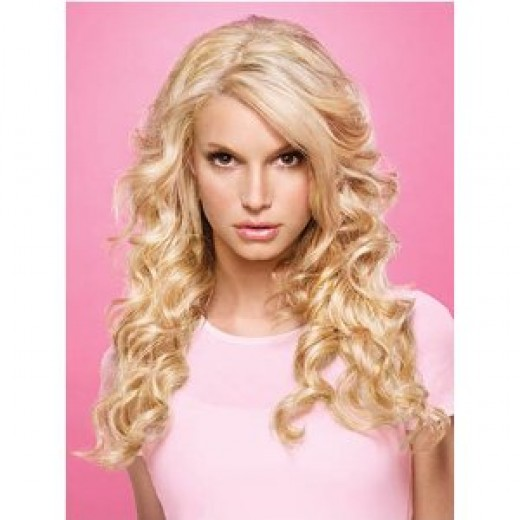 "Get luxurious ""mermaid"" hair with Hairdo Relaxed Curl Extensions in 22 inches."