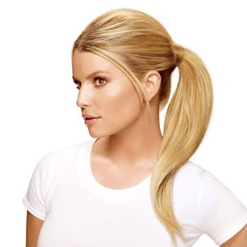 Buy a ponytail hair extension and use one while you grow your hair out.