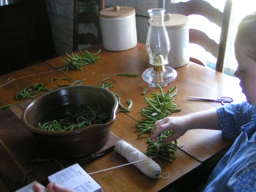 Stringing beans, inside the Wittmer-Ross House (ca. 1844)
