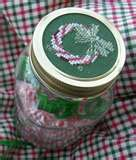 Gifts in a jar with a decorative cross stitch lid