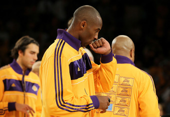 Kobe kissing his Championship RIng which was presented to all Lakers on Season Opening Night October 26, 1010 at Staples Center