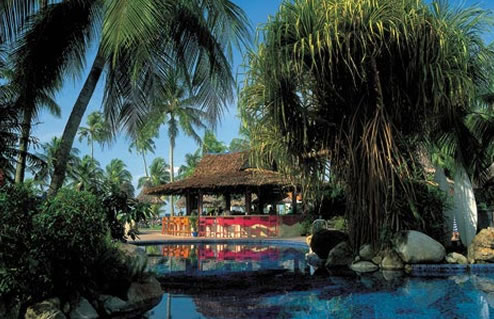 Little tropical huts are located in the innver garden.