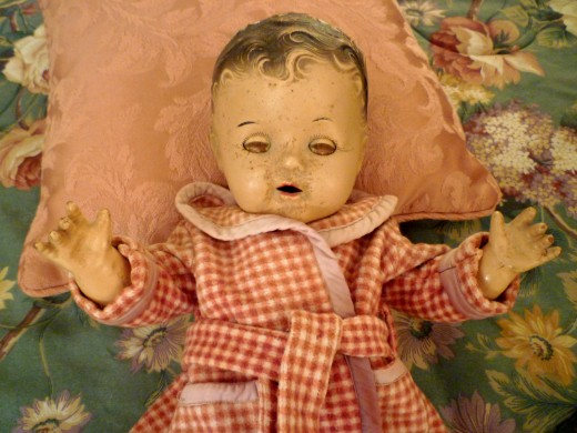 My mother's doll Annette with eyes half closed.