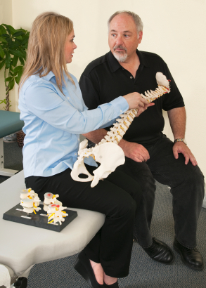 Chiropractor explaining a spinal condition