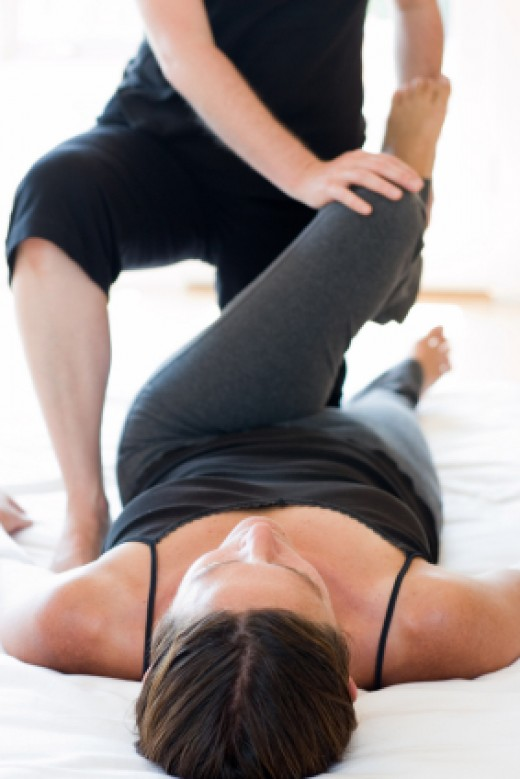 Yoga Theraptis working with a patient